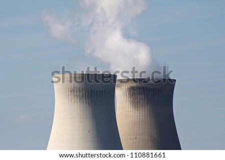 Cooling towers at a nuclear power plant - stock photo