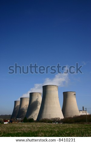 Cooling towers of a coal-fired power station against blue sky - stock photo