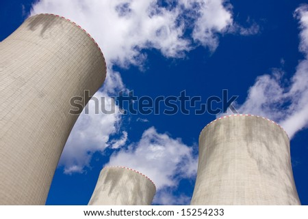 Cooling towers of a nuclear power plant - stock photo