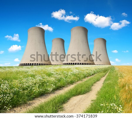 Cooling towers of a nuclear power plant. - stock photo