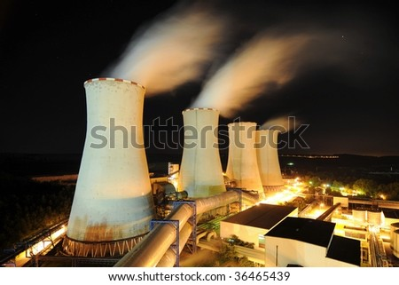 Cooling towers of a power plant - stock photo