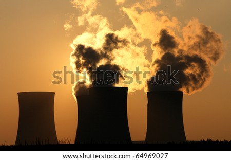 cooling towers of nuclear power plant during sunset - stock photo