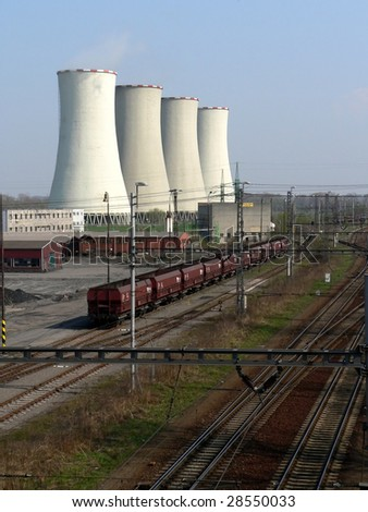 Cooling towers of power station with wagons and track - stock photo