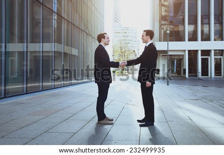 cooperation concept, handshake of two business men  - stock photo