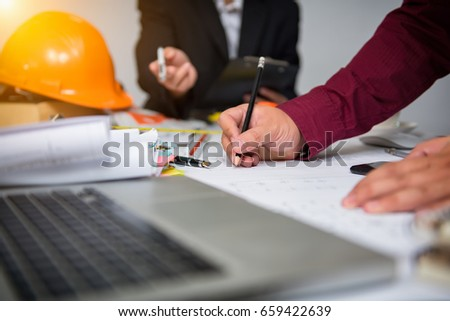 Cooperation Corporate Achievement Planning Teamwork ConceptClose-up Of Person's engineer Hand Drawing Plan On Blue Print with architect equipment.