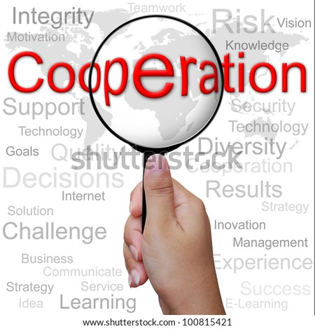 Cooperation, word in Magnifying glass ,business background - stock photo