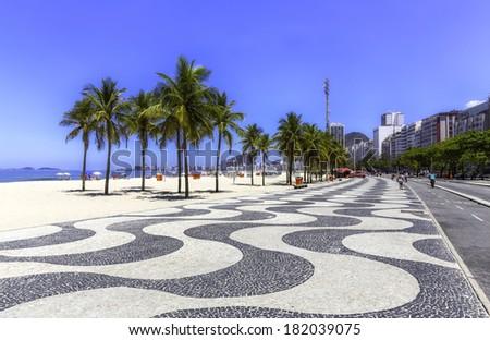 Copacabana beach with palms and sidewalk in Rio de Janeiro, Brazil - stock photo