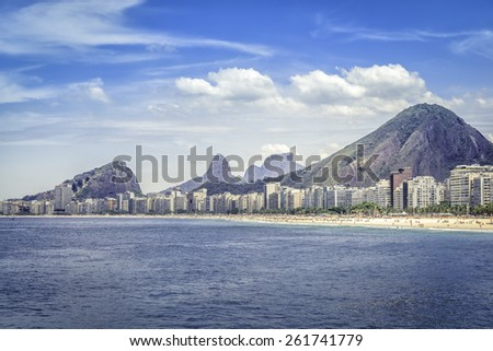 Copacabana beach with people and buildings on hot summer day in Rio de Janeiro, Brazil - stock photo