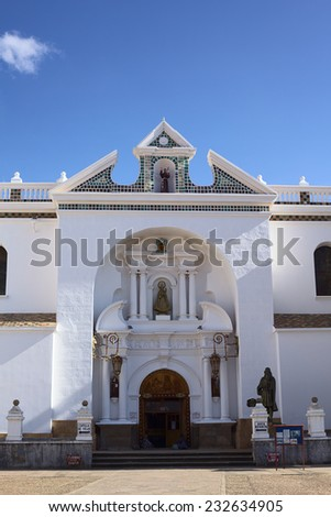 COPACABANA, BOLIVIA - OCTOBER 19, 2014: The entrance of the Basilica of Our Lady of Copacabana in the small tourist town along the Titicaca Lake on October 19, 2014 in Copacabana, Bolivia  - stock photo