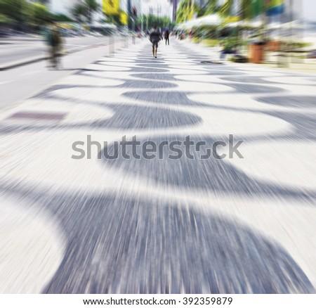 Copacabana sidewalk - blur - radial - stock photo