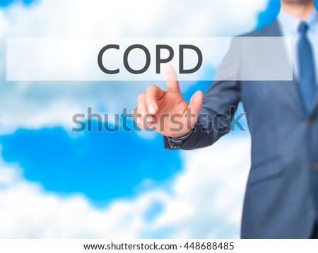 COPD - Businessman hand touch  button on virtual  screen interface. Business, technology concept. Stock Photo