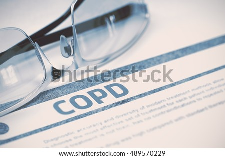 COPD - Chronic Obstructive Pulmonary Disease - Medicine Concept with Blurred Text and Spectacles on Blue Background. Selective Focus. 3D Rendering.