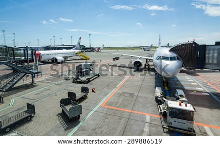 COPENHAGEN AIRPORT - JUNE 14: Summer landscape of airfield area with awaiting airplaines, June 14 in Copenhagen, Denmark. International airport with over 25 million passengers every year. - stock photo