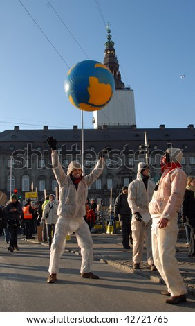 COPENHAGEN - DEC 12: Demonstrators play a globe in front of the parliament at the UN Climate Change Conference on December 12, 2009 in Copenhagen, Denmark. - stock photo