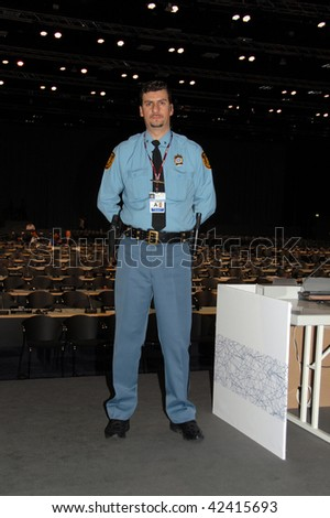 COPENHAGEN DEC 7: Opening Day, UN policeman and security investigator on guard at the Bella Center at the UN Climate Change Conference opens on December 7, 2009 in Copenhagen, Denmark. - stock photo