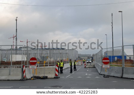 COPENHAGEN – DEC 5: Police stand guard at a security checkpoint at the Bella Center outside the UN Climate Change Conference on December 5, 2009 in Copenhagen. - stock photo