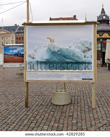 COPENHAGEN - DEC 12: Poster showing a hole in the ice which is part of the WWF during the UN Conference on Climate Change on December 12, 2009 in Copenhagen. - stock photo