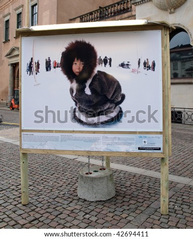 COPENHAGEN - DEC 12: Poster showing an eskimo which is part of the WWF exhibit in Copenhagen during the Climate Conference December 12, 2009 - stock photo