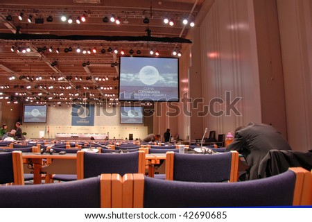 COPENHAGEN - DEC 12: Sleeping delegate in the conference hall at the UN Climate Change Conference on December 12, 2009 in Copenhagen. - stock photo