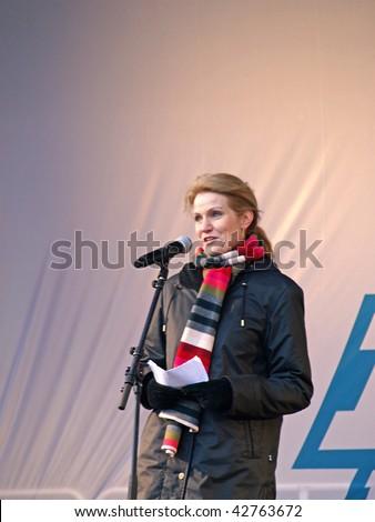COPENHAGEN - DEC 12: Social Democratic party leader, Helle Thorning Schmidt speaks at the Climate Change Demonstration in front of  the Parliament of Denmark on December 12, 2009 in Copenhagen Denmark. - stock photo