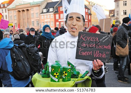 COPENHAGEN - DECEMBER 12: Caricature of USA president Barack Obama carrying nuclear equipment on plate during environment protest, in state central market, December 12, 2009 in Copenhagen, Denmark. - stock photo