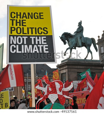COPENHAGEN - DECEMBER 12: People with signs gather for an environment protest in state central market, December 12, 2009 in Copenhagen, Denmark. - stock photo
