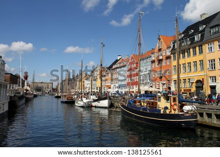 COPENHAGEN, DENMARK - APR, 28th, 2013: Nyhaven is most popular place in Copenhagen with lot of boats and tourists on 28th April 2013. - stock photo