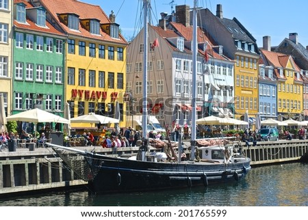 COPENHAGEN, DENMARK. APRIL 9. The Borsgade, in Copenhagen, is a popular destination for tourists and locals, where restaurants and tour boats are available. April, 9, 2014, in Copenhagen, Denmark. - stock photo