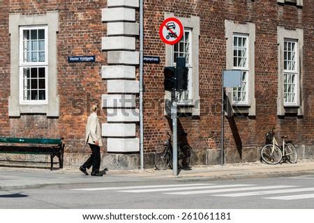 COPENHAGEN, DENMARK - AUGUST 12: Walking man on August 12, 2014 in Copenhagen. - stock photo