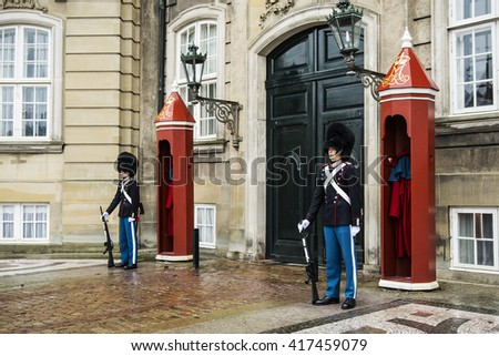 COPENHAGEN, DENMARK - JANUARY 2, 2014: unidentified soldiers of the Royal Guard in Amalienborg Castle guarding the entrance on January 2, 2014 in Copenhagen, Denmark