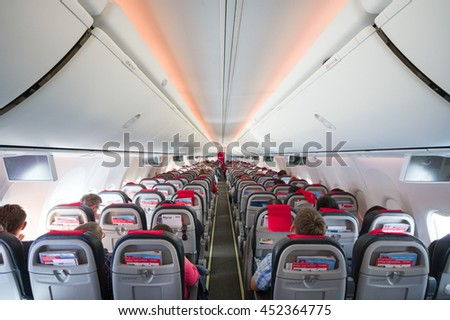 COPENHAGEN, DENMARK - July 6, 2016: Interior of Norwegian Boeing 737 during the flight.