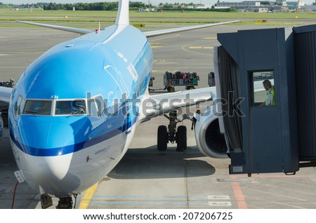 COPENHAGEN, DENMARK - JUNE 7: A KLM airplane ready to receipt passengers, on June 7, 2014. KLM is one of the most knowed aircraft lines in the world