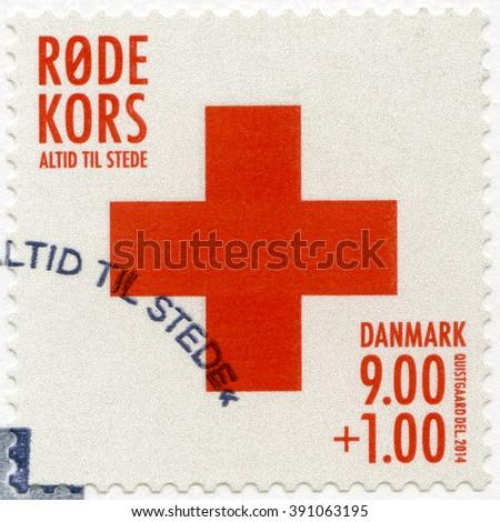 COPENHAGEN, DENMARK - JUNE 03, 2014: A stamp printed in Denmark shows Red Cross - stock photo