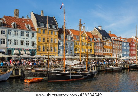 COPENHAGEN, DENMARK - 4 JUNE, 2016. Nyhavn district one of the most famous landmark. Colorful houses and boats on shore. Cityscape with waterfront. Tourist place. Beautiful view with sailboats, masts.