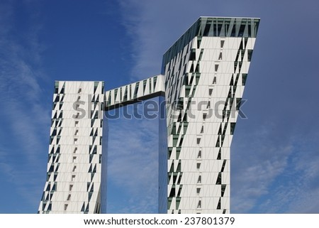 Copenhagen Denmark - June 7, 2014: The Bella Sky Comwell Hotel is a 4-star conference hotel adjacent to the Bella Convention and Congress Center in the Orestad district of Copenhagen, Denmark.  - stock photo