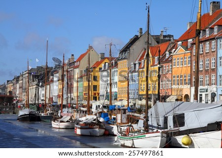 COPENHAGEN, DENMARK - MARCH 11, 2011: People visit Nyhavn district in Copenhagen, Denmark. Cophenhagen is the most visited city in Nordic countries with 1.3 million annual tourists. - stock photo