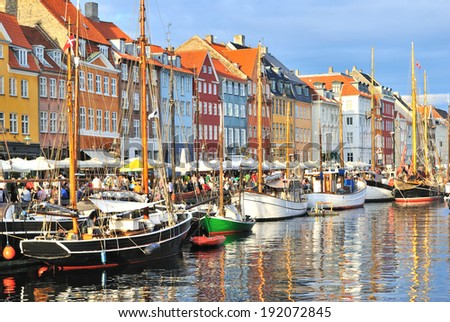 Copenhagen, Denmark. Nyhavn harbor  in a sunny evening after the rain