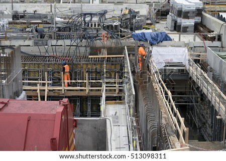 COPENHAGEN, DENMARK - OCTOBER 25 2016:  Construction site with workers for the realization of a new subway in the Town Hall Square in Copenhagen. October 25, 2016, Denmark