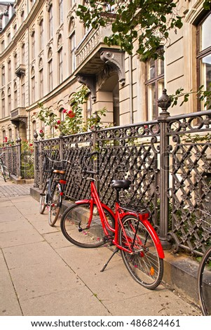 Copenhagen, Denmark - September, 02, 2016 Parked Bicycles On Sidewalk in historic part of Copenhagen, Denmark on September, 02, 2016