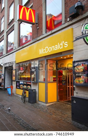 COPENHAGEN - MARCH 10: McDonald's restaurant on March 10, 2011 in Copenhagen, Denmark. With 4.9bn USD announced net income (2010) it is the top fast food chain worldwide. - stock photo