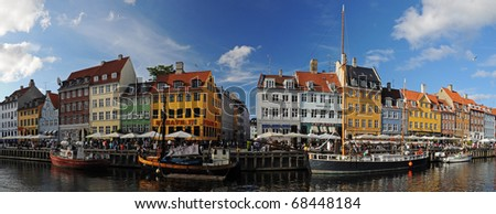 Copenhagen (Nyhavh) in a sunny summer day, panorama of old historical harbor, Denmark - stock photo