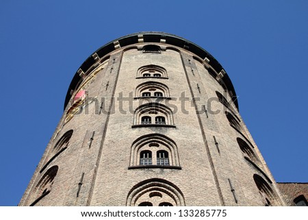Copenhagen Old Town - capital city of Denmark. Famous vintage astronomical observatory - Round Tower (Rundetarn). Oresund region. - stock photo