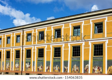 Copenhagen - old yellow building with wall painting in historical center of Copenhagen, Denmark. - stock photo