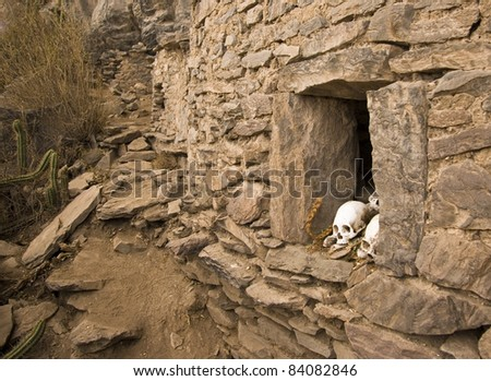 Coporaque Peru Inca Burial site; showing skull in front of burial chamber - stock photo