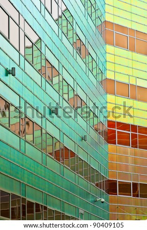 Copper Building with mirrors in green and yellow