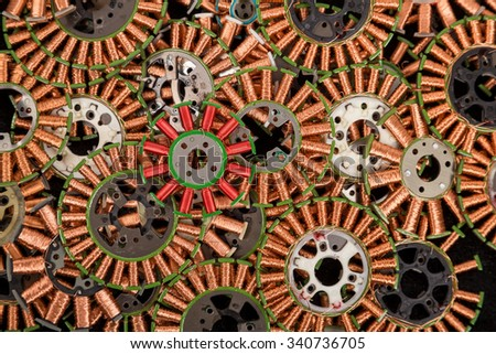 Copper coils as old parts of floppy drives, industrial background - stock photo