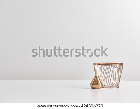 copper cup and basket behind empty layout - stock photo