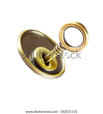 Copper key in keyhole isolated on white background - stock photo