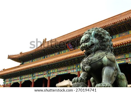Copper lion in front of an ancient architecture in Forbidden city, Beijing China - stock photo