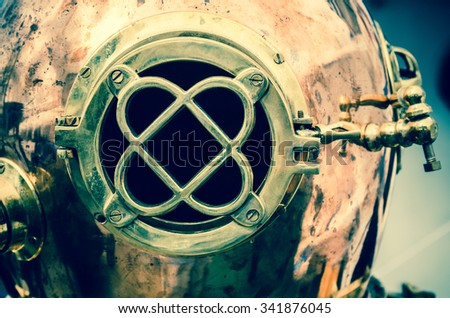 Copper old diving helmet, close-up - stock photo